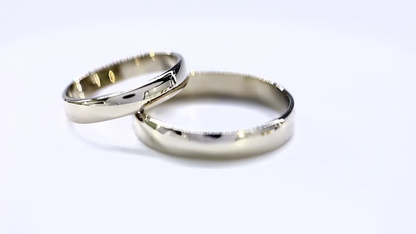 White Golden Wedding Rings With Diamond Rotation Loop