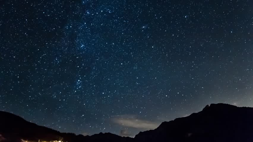 stars and moon in mountain night sky. Moonrise timelapse in 4K. Italy alps