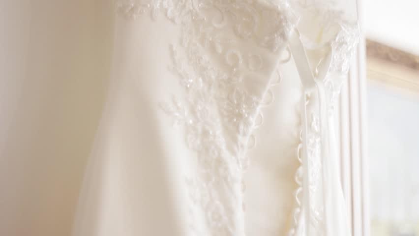 Wedding Dress Fabric.Wedding Dress Hanging On The Stock Footage Video 100 Royalty Free 20780863 Shutterstock