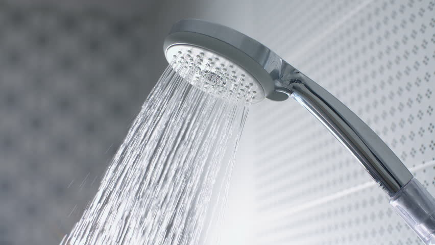 Cool, Clean Water Streams Down From A Shiny Metal Shower Head ...