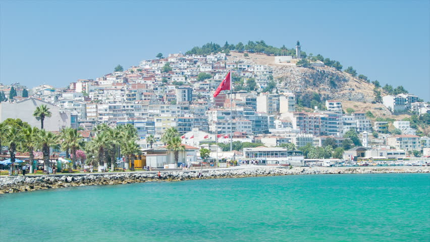 Turkish Resort Destination of Kusadasi Turkey Vibrant Seaside Setting with Buildings and Flags against a Mountain Hill during Sunny Weather | Shutterstock HD Video #20792023