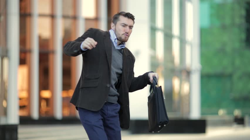 Attractive man with a beard and briefcase dancing in the street | Shutterstock HD Video #20821513
