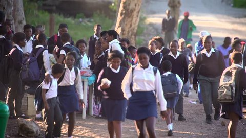 African school children walking to school in morning light.Circa Cape Town,October 2016