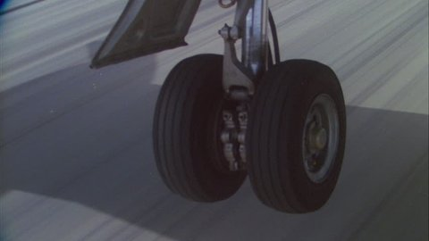 day CU wheels tires ND plane fighter jet , landing ND runway, bounces connects ground