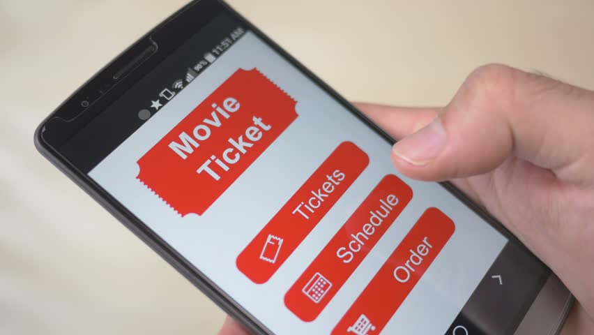 Movie theatre ticket showing on a smartphone screen. Digital eTicket.