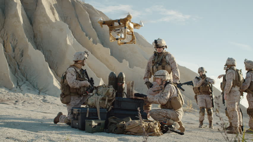 Soldiers are Using Drone for Scouting During Military Operation in the Desert. Slow Motion. Shot on RED EPIC Cinema Camera in 4K (UHD).