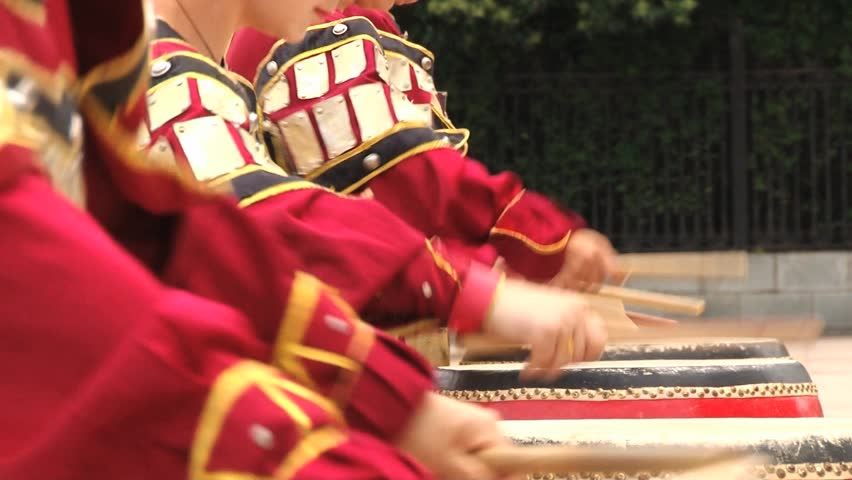 XIAN, CHINA - MAY 29, 2013: Unidentified people play traditional drum instruments in the Datang Furong Garden in Xian, China.