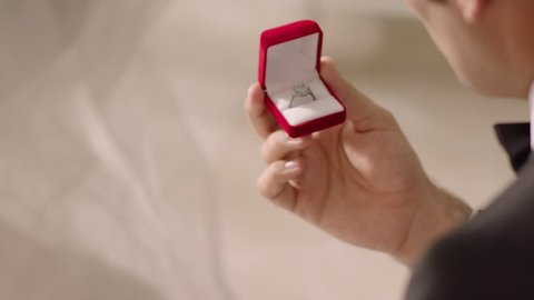 marriage proposal in slow motion, wearing ring, ring box, diamond ring, getting married, wedding day,bride and groom
