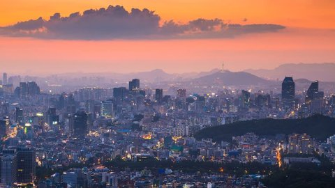 Beautiful cityscape in sunset of Seoul, South Korea, Seoul tower modern building and architecture. Timelapse.
