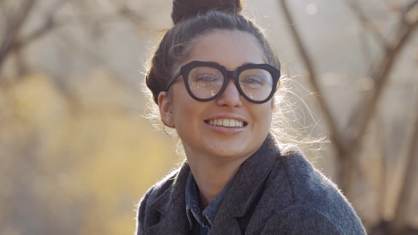 Urban Model Woman in Fashion coat and glasses Having Fun. Glamour Sexy Hipster Girl, Trendy Hairstyle in Autumm Streets Joking. Student Fall Fashion. | Shutterstock HD Video #20937043