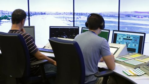 Sofia, Bulgaria - September 12, 2016: Air traffic controllers at work in the flight control tower at Sofia's airport.