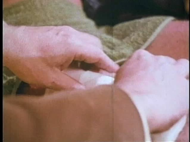 Close-up of person removing patch to reveal thigh wound