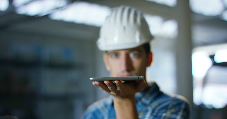 A worker uses a future technology platform to verify the design in holography and augmented virtual reality. Concept: future technology, multimedia technology, futuristic engineering. | Shutterstock HD Video #20989357