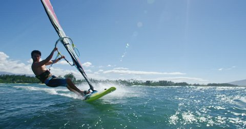 Windsurfer gets big air jumping off wave, Extreme sport