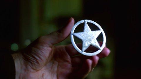 A sheriff badge, law enforcement concept