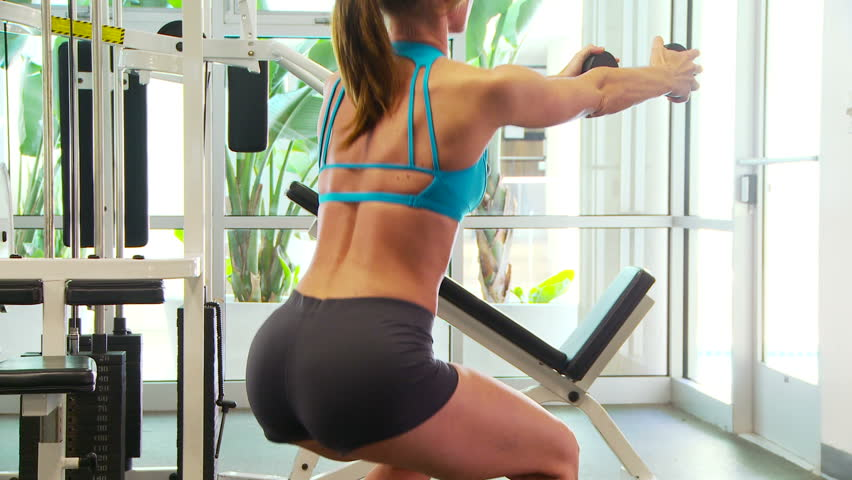 Woman working out doing squats