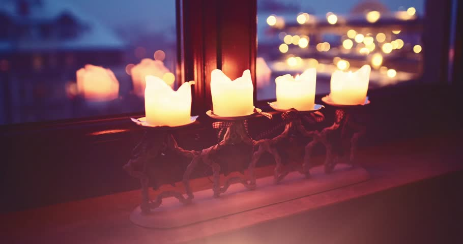 Christmas Candles Burning on the window, Quiet Snowy Winter Neighbourhood Background. 4K DCi SLOW MOTION 120 fps. Snowfall on Xmas Eve. Winter Holidays Concept. Advent Traditions. DOLLY SHOT