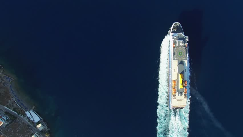 A large ferry sails on the sea near the Islands. Camera at high altitude over the ship. Foamy track behind the stern. Aerial view. | Shutterstock HD Video #21057373