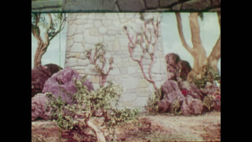 ANIMATED 1950s: Young man calls up to Rapunzel. Witch has an idea about Rapunzel's cut hair.