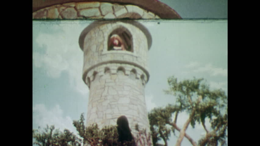 ANIMATED 1950s: Rapunzel sees a witch at the bottom of the tower she lives in. Rapunzel lets her hair down so the witch can climb up to the tower. Witch touches Rapunzel's hair and gets a shock.