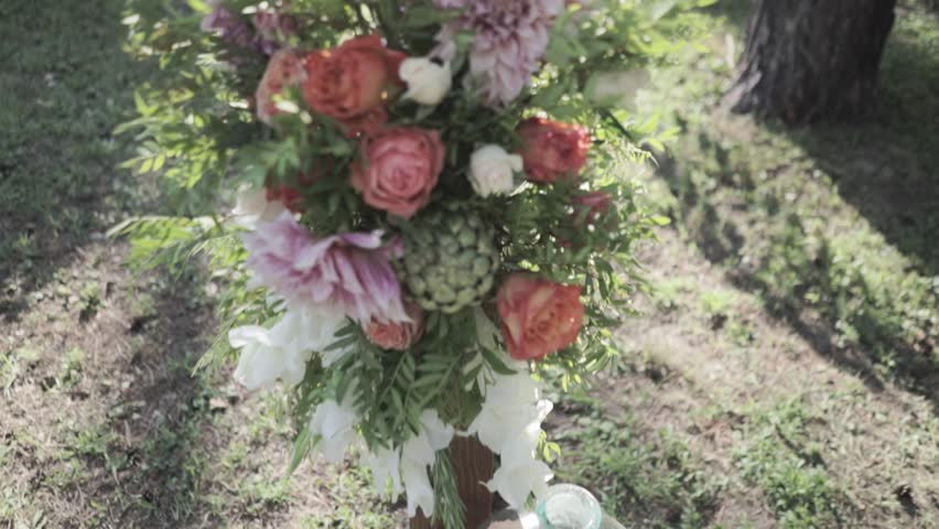 Outdoor wedding ceremony decoration before reception. Beautiful flower composition in sunlight. | Shutterstock HD Video #21074035