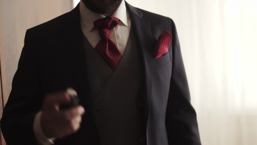 Closeup of stylish caucasian man in a suit use the perfume. | Shutterstock HD Video #21074134