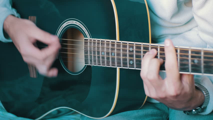 Man Playing Acoustic Guitar Playing On Acoustic Guitar With Over