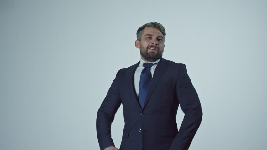 Portrait of bearded businessman thrusting hands in air and celebrating as money falling on him from above | Shutterstock HD Video #21121273