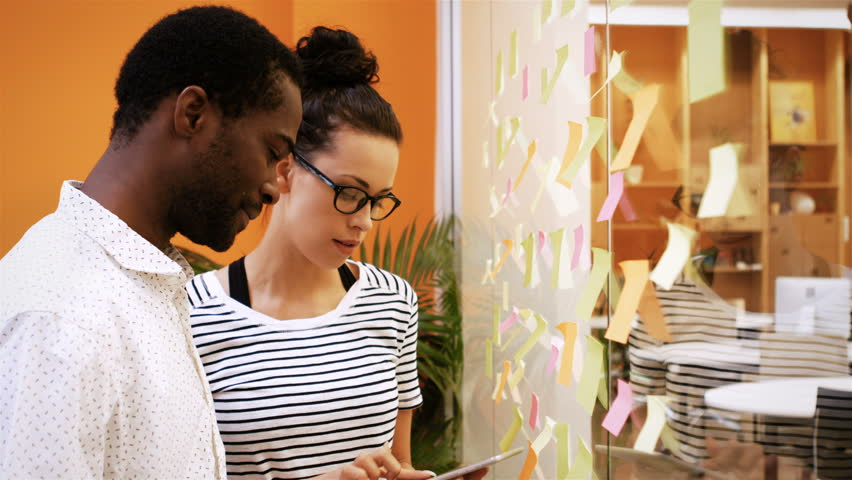 Business colleagues brainstorming in the office   Shutterstock HD Video #21122809