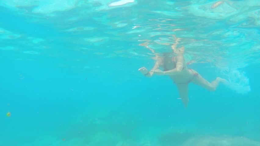 Beautiful woman swimming underwater on paradise beach freedom wellbeing lifestyle summer vacation wanderlust Gopro #21166423