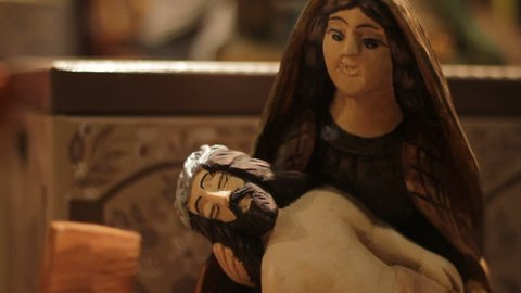 Wooden Jesus Christ and Virgin Mary at store display
