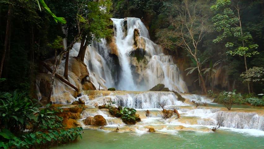 4K Cascade of Kuang Si waterfall or Kuang Xi or Tat Kuang Si Falls, South of Luang Prabang, Laos. Slow Motion Shot.