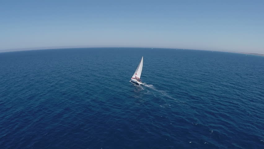 Sailing yachts with white sails in the open Sea. Drone view