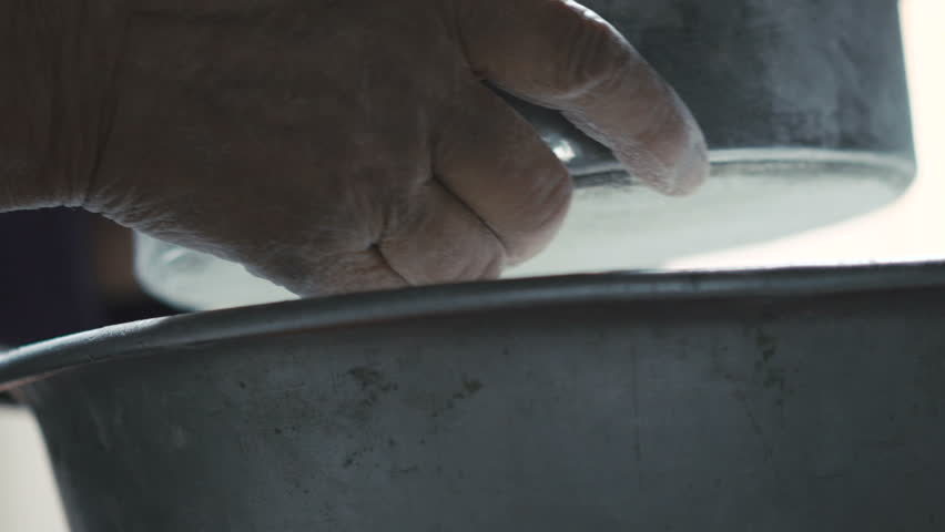 Close up wrinkled old woman's hands sifting the flour through the sieve | Shutterstock HD Video #21217063