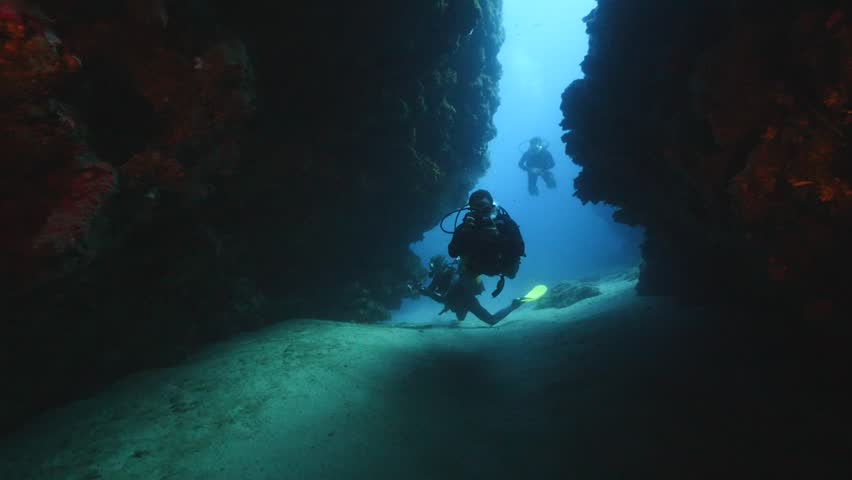 Diver exploring the underwater tunnel | Shutterstock HD Video #21229723