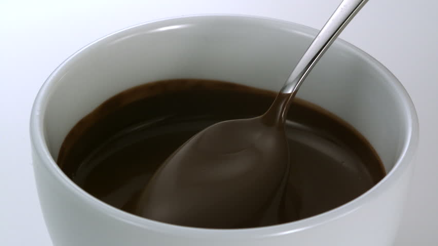 Close-up chocolate fodue being stirred with spoon