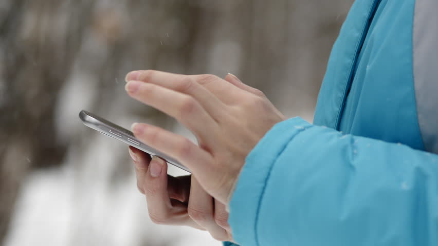 Woman Text Browsing Online Smartphone In Winter Forest, Snowy Weather Day | Shutterstock HD Video #21264841