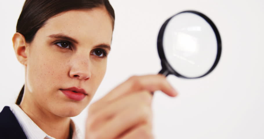 Woman Looking Through A Magnifying Glass, Gray Background