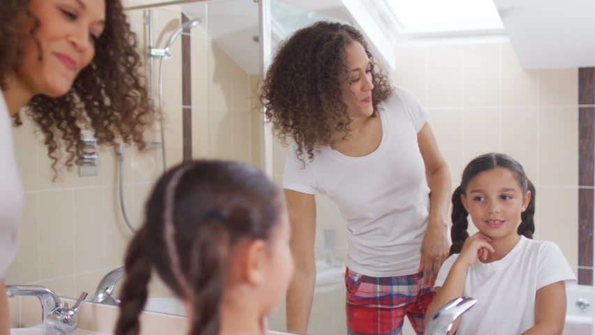 4K Mother   daughter get ready in the bathroom in the morning  mother  styling little. Happy Caucasian Family With Two Children Relaxing At Home  Kids