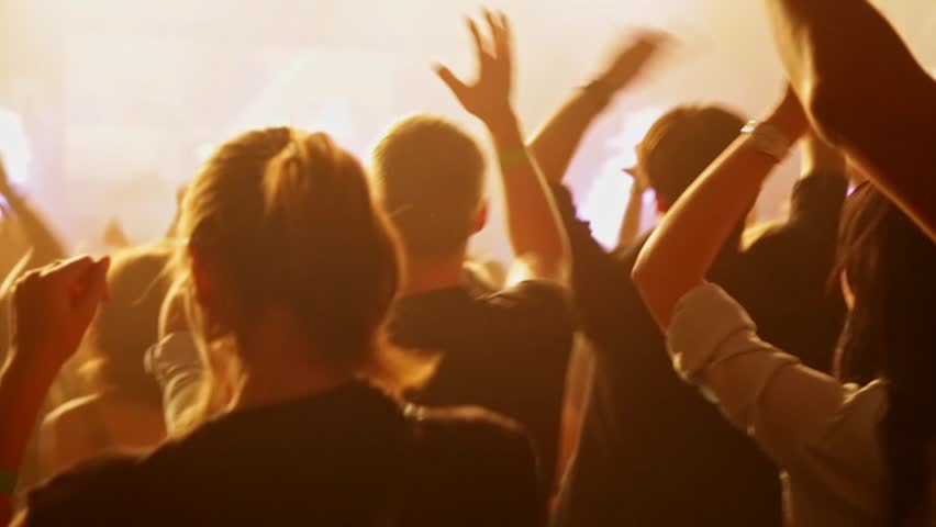 Crowd dancing at music concert. Close-up
