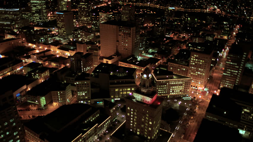 Aerial night illuminated view of city blocks and road systems in a developing city, America