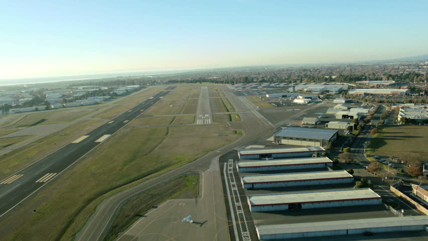 Aerial time lapse view of a plane landing and taxiing at an airport