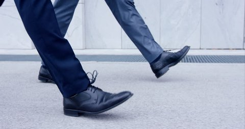 Slow-Mo Close-Up On Feet Of Two Business Men Walking In Traditional Custom