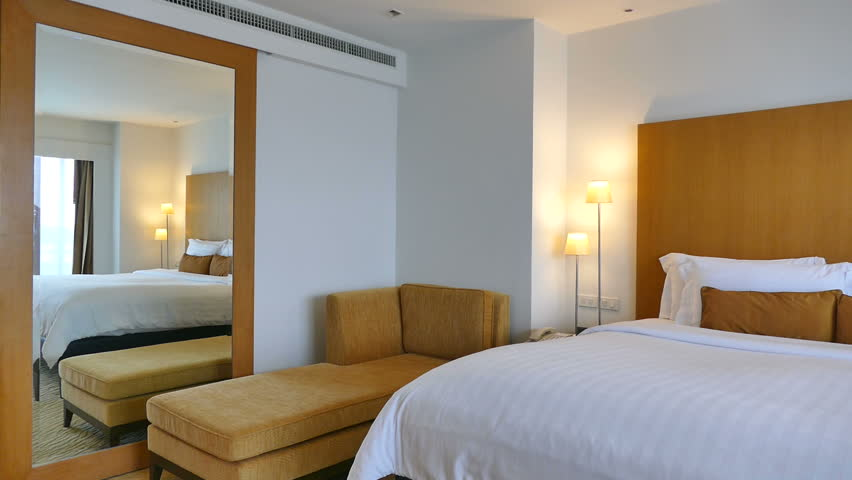 elegant bedroom interior design young man in elegant bedroom stands by the window to look at the