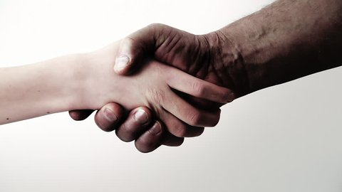 Handshake. Black and white. Reconciliation. Friendship. White Background. Connection of the generations. Removal of racial differences.  Clip ID: handshake1_ HD