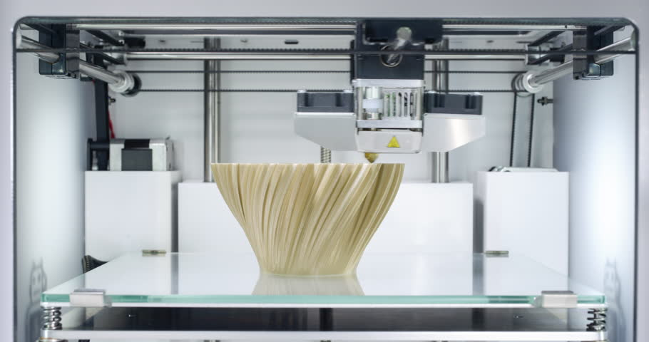 3D printer, printing a fractal vase - Zoom-In at the end.  Vase by BenitoSanduchi licensed under Creative Commons - Attribution - Share Alike license. Source: http://www.thingiverse.com/thing:37117  | Shutterstock HD Video #21335164