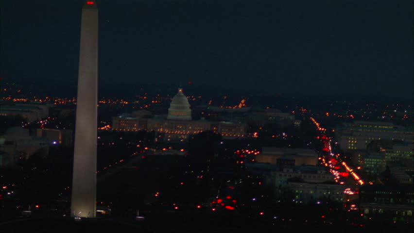 Night Aerial Over Washington DC, holding Capitol Building, passes Washington Monument