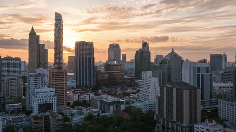 4K Day to Night timelapse of Bangkok building city skyline at sunset with garden on top view