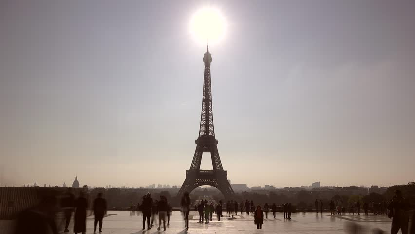 Sun shinning on the Eiffel tower top, people moving fast close famous art structure, time lapse | Shutterstock HD Video #21397333