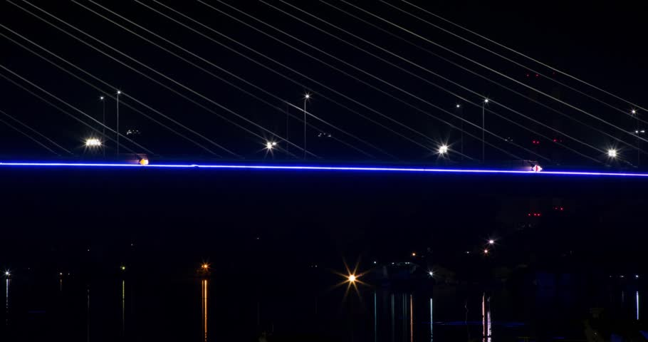Night time lapse of a bridge, at night. Boats passing. #21423613